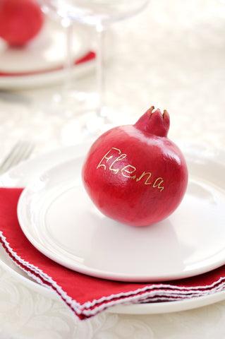 Etched pomegranates as a table place cards for holiday parties and dinners