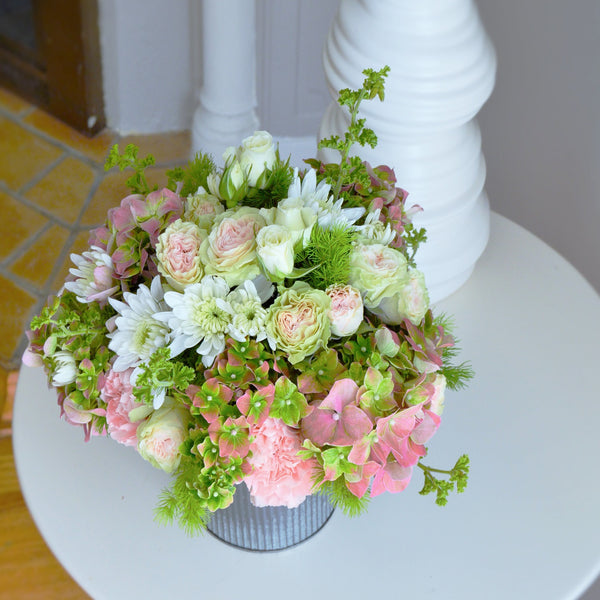 Garden Hydrangeas | Pink and Green hydrangeas | White Spray Roses | Pink Spray Roses | Geranium | White Mums