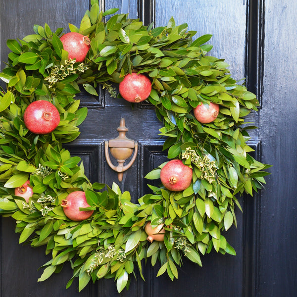 Bay and Pomegranate Wreath | Club Botanic | Fresh Bay Leaf Wreath for Christmas | Fresh Bay Wreath for the Holidays | Wreath with Pomegranates for Christmas | Christmas Pomegranate Wreath