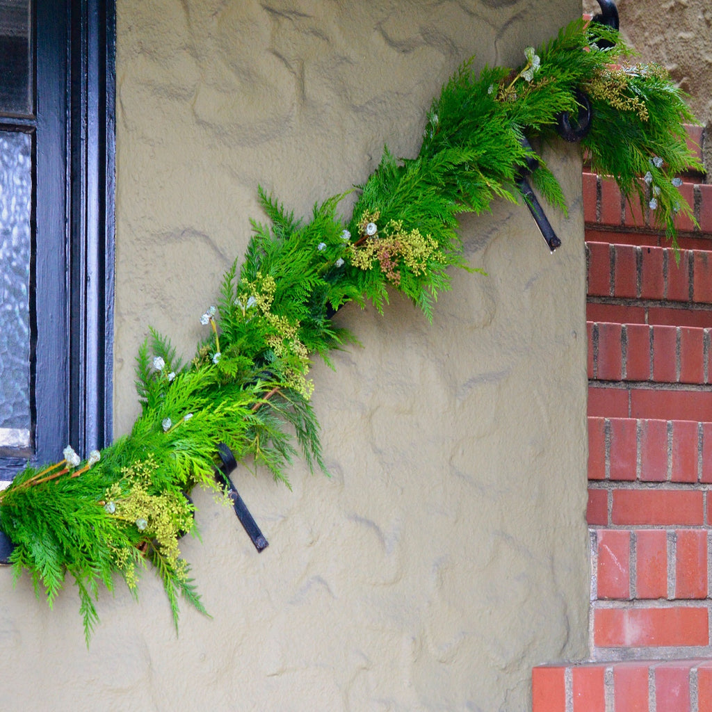 Mendocino Holiday Cedar Garland | Club Botanic | Outdoor Garland for Porch | Outdoor Garland Staircase | Fresh Greenery for Christmas | Cedar Garland with Eucalyptus on outdoor staircase
