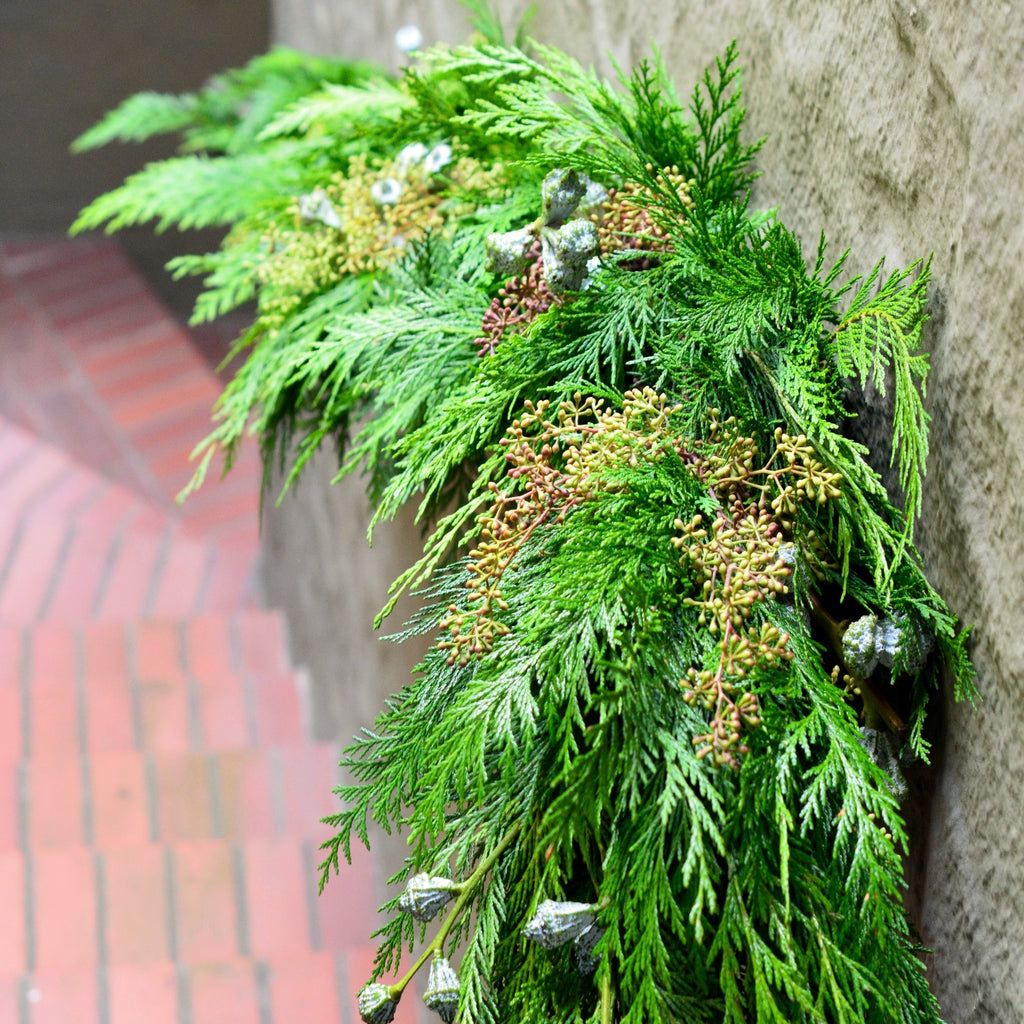 Mendocino Holiday Cedar Garland | Club Botanic | How to Display Garland on Porch for the Holidays | Cedar and Eucalyptus Garland that hangs along staircase rail outside