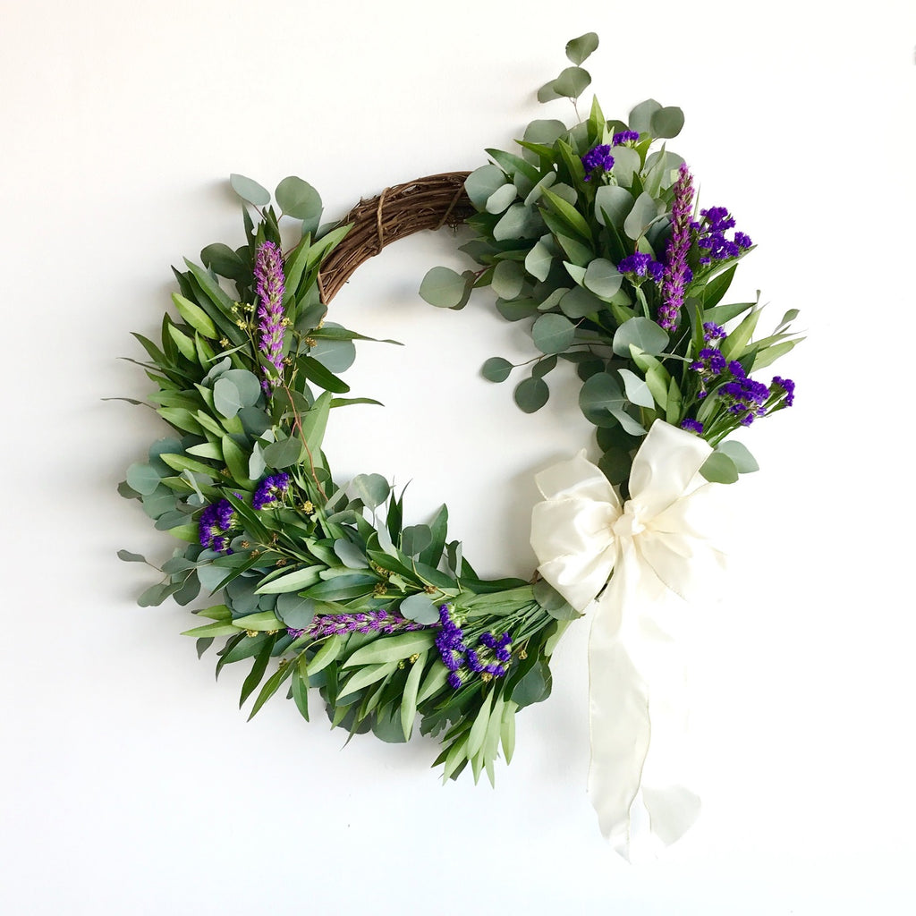 Bodega Bay Crescent Wreath | Club Botanic | Fresh Wreath for Front Door | Fall Wreath for Door | Silver Dollar Eucalyptus and Bay Leaf Wreath |  Statice Wreath for Spring | Asymmetric Wreath | Thanksgiving Wreath with Bay Leaf, Eucalyptus | Wreath with Satin Bow | Fresh Wreath with White Bow | Violet Wreath for Summer