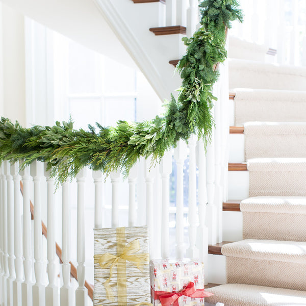 Fresh cedar garlands | noble fir garland | Variegated boxwood garland | Garland hanging down a staircase
