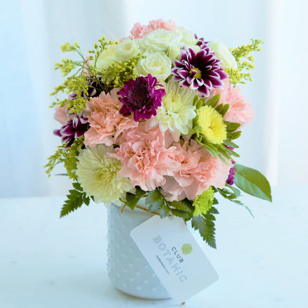 Fresh bouquet of mixed flowers of pink, purple and white chrysanthemums
