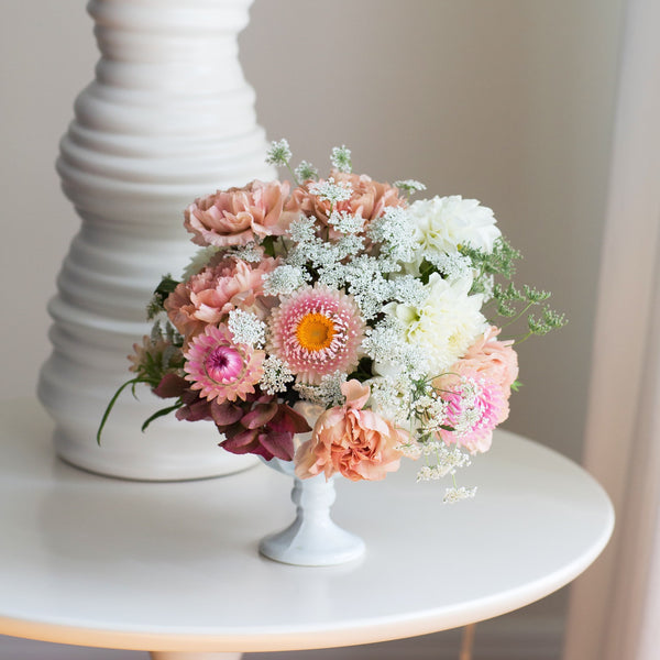 Pink Carnations, Hydrangea, White Mums in white footed urn