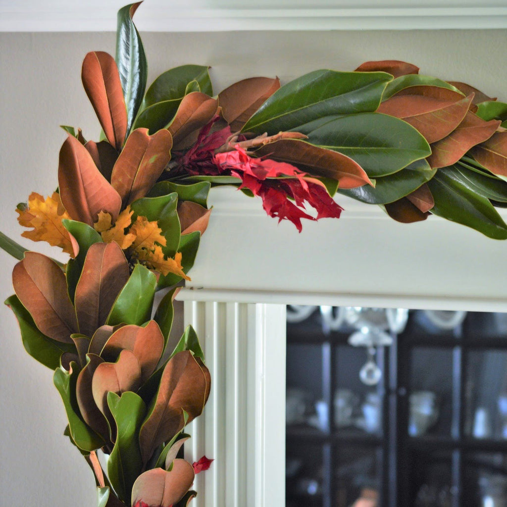 Magnolia and Red Oak Garland for Fall | Garland for Thanksgiving Red Oak and Magnolia Leaf | Christmas Magnolia Garland | Holiday Magnolia Leaf Garland | Magnolia with red oak garland handing over door inside home | outdoor magnolia leaf garland | fall oak garland