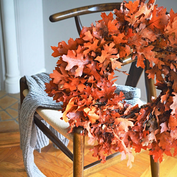 Oak Leaf Wreath | Rustic Oak Wreath | Orange Oak Wreath | Fall Oak Wreath for Front Door | Oak Leaf hanging on side of chair with sweater draped over the chair