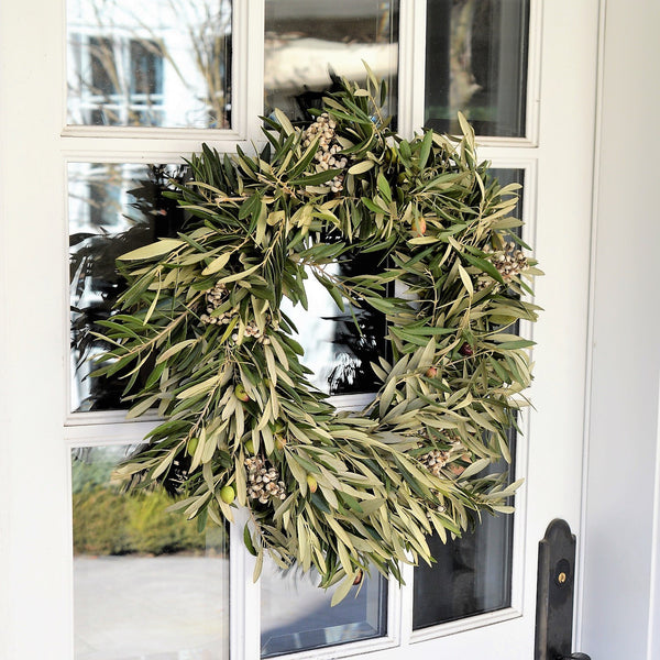 Olive and Tallowberry Wreath | Club Botanic | Olive Christmas Wreath | Olive Holiday Wreath | Olive Door Wreath | Fresh Olive Wreath with White Berries on Wooden Door