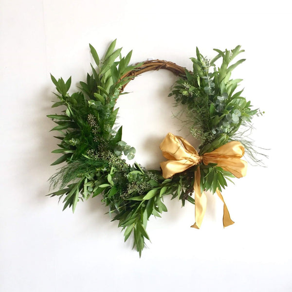 St. Helena Grapevine and Bay Wreath | Club Botanic | Fresh Wreath for the Fall | Fall Wreath for Door | Baby Eucalyptus and Bay Leaf Wreath for Fall | Tree Fern Wreath for Fall | Asymmetric Wreath | Thanksgiving Wreath with Bay Leaf, Baby Eucalyptus | Wreath with Gold Ribbon | Fresh Wreath with Yellow Ribbon