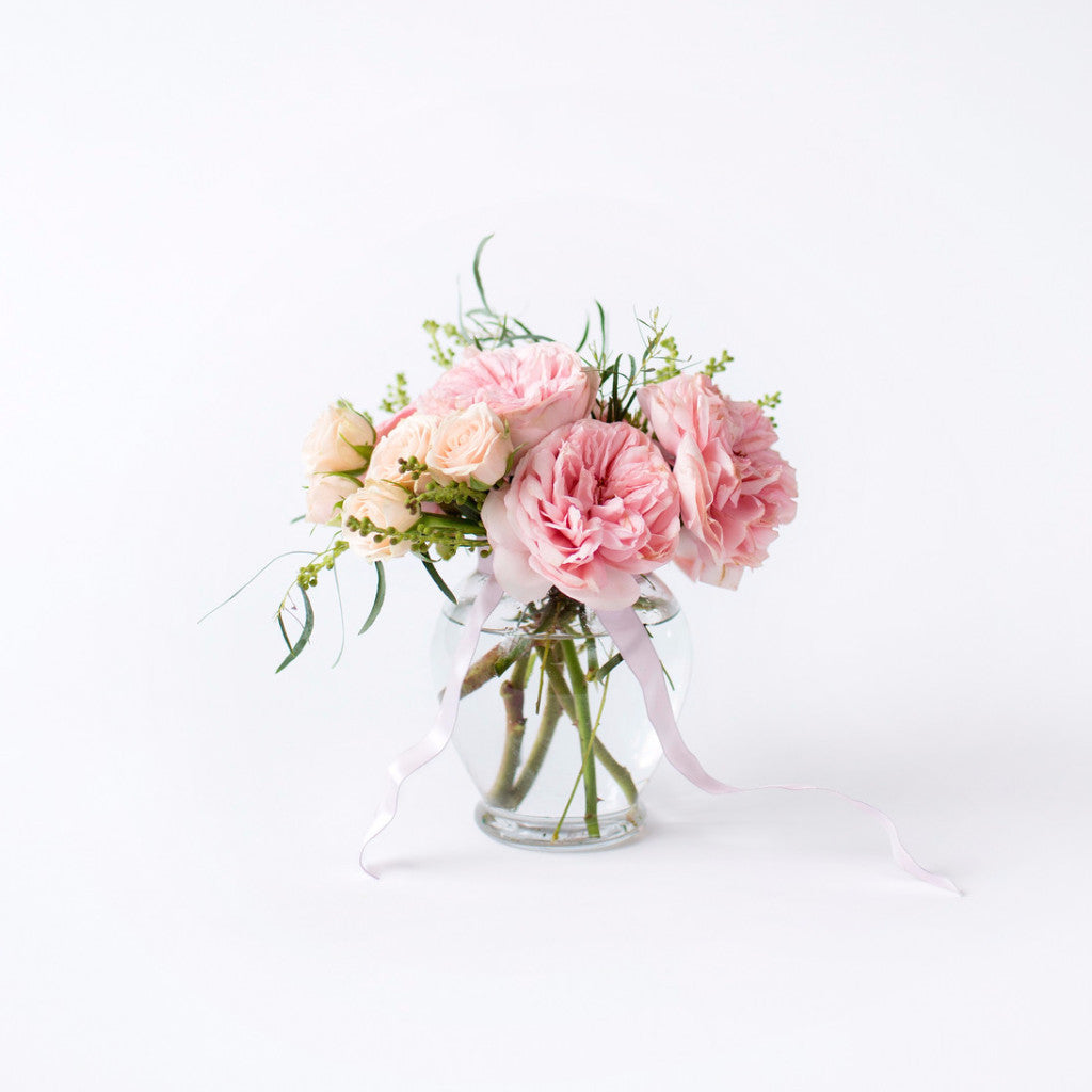 Pink Garden Roses and White Spray Roses Arranged in a Ginger Jar