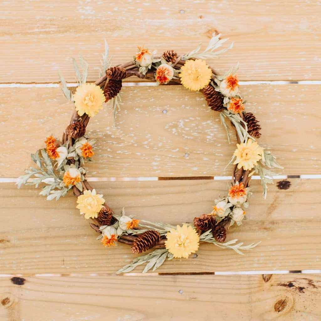 Yellow safflowers on wooden vine wreath accented by olive and baby pine cone | vine wreath with yellow safflowers,olive and baby pine cones