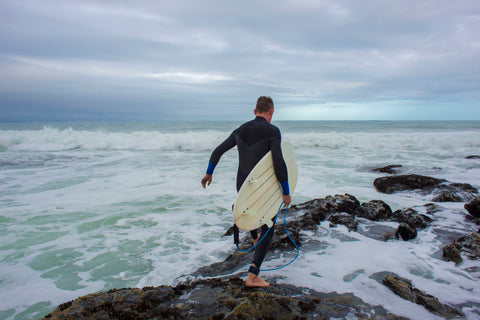 winter wetsuit on big wave surfer