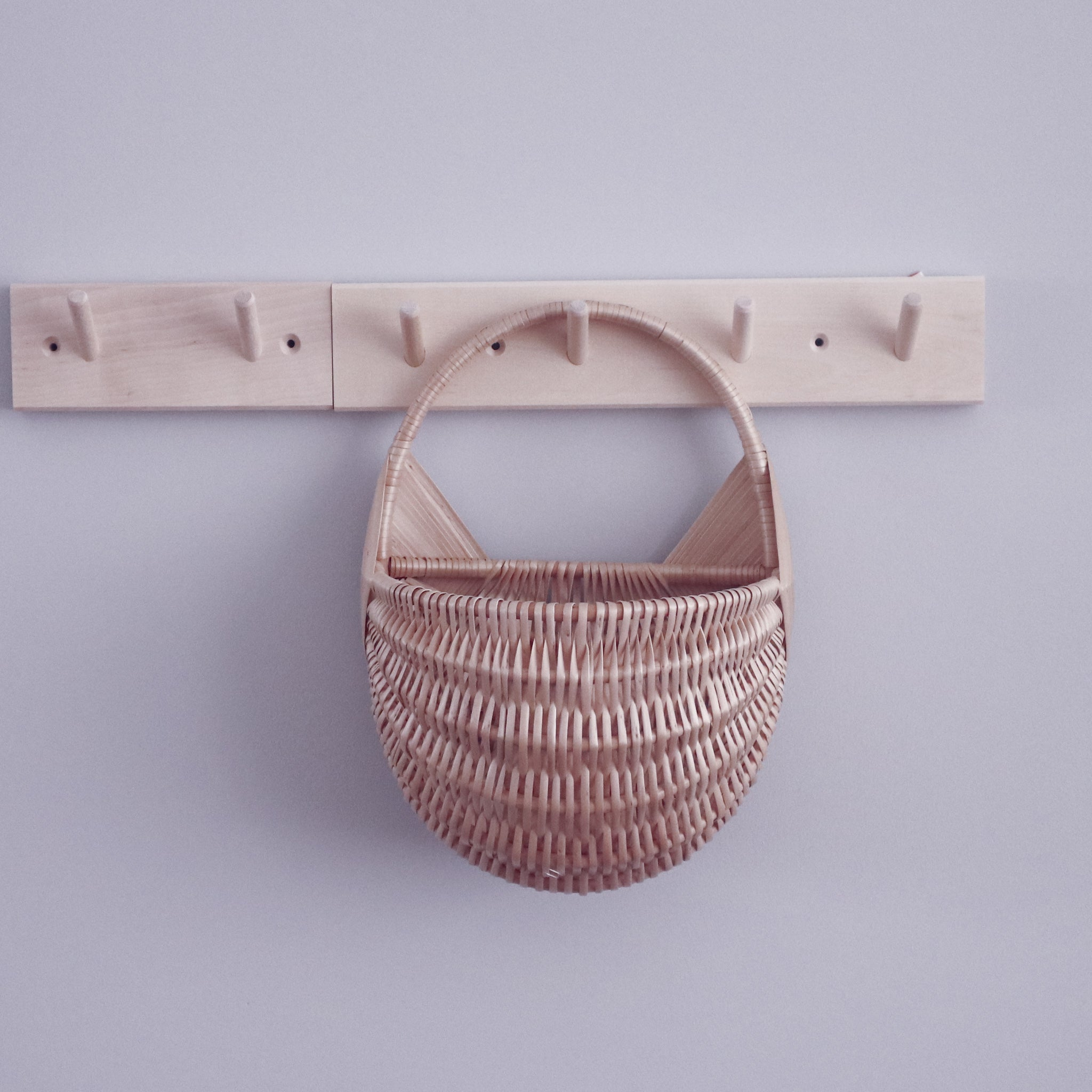 wicker wall basket on wooden hanger