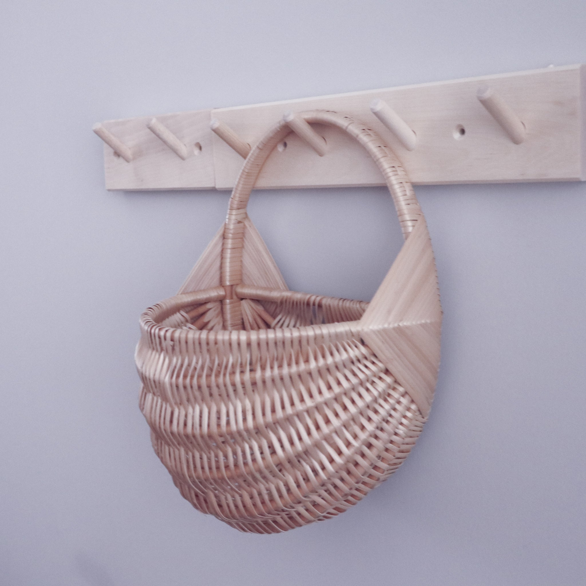 rattan wall basket in wall wooden hanger