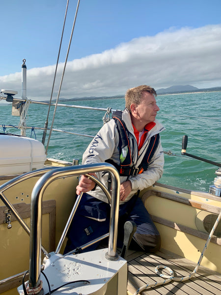 Ian Herbert Jones at the helm of his yacht Puffin, wearing a TeamO BackTow lifejacket