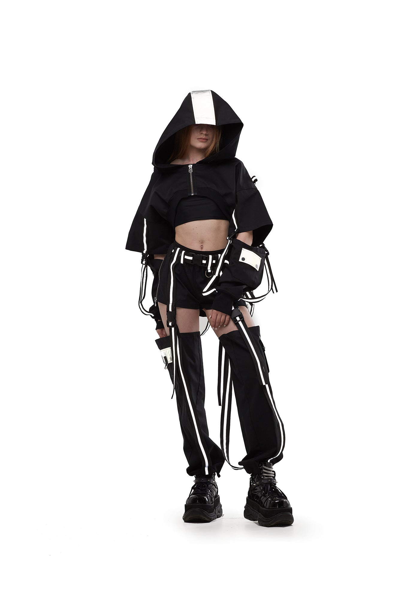 Hooded shrug in Black with reflective straps.