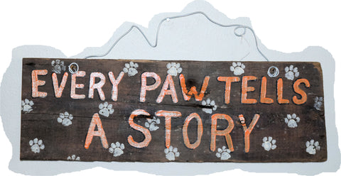 Every Paw tells a Story (orange lettering white paws)