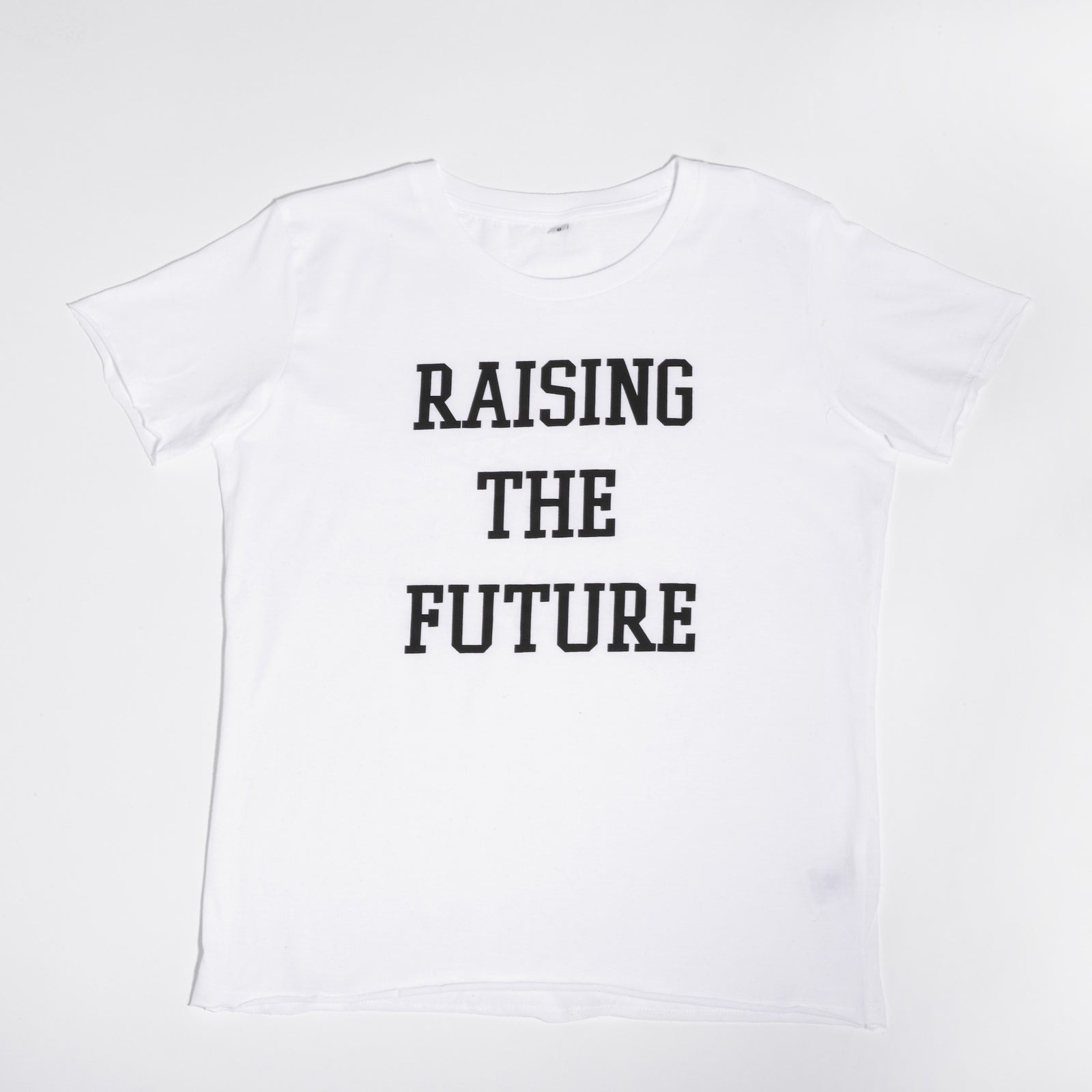 Raising The Future White T-Shirt by Mère Soeur. Twinning action with our matching The Future shirt. Mere Soeur is a lifestyle brand dedicated to celebrating sisterhood and empowering mums.