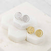 Gold, silver eclipse studs, white topaz, unique British design, minimalist