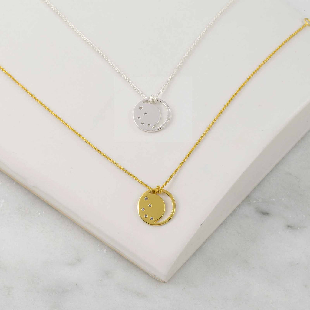 Gold, silver eclipse necklace, white topaz, unique British design