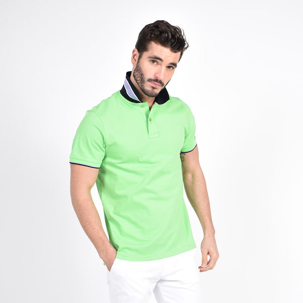 Green polo with two-button placket and reversible black collar: white and gray stripe design on reverse.