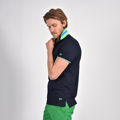 Navy-blue polo with reversible collar, striped armbands, and embroidered green EX logo on sleeve and bottom hem.