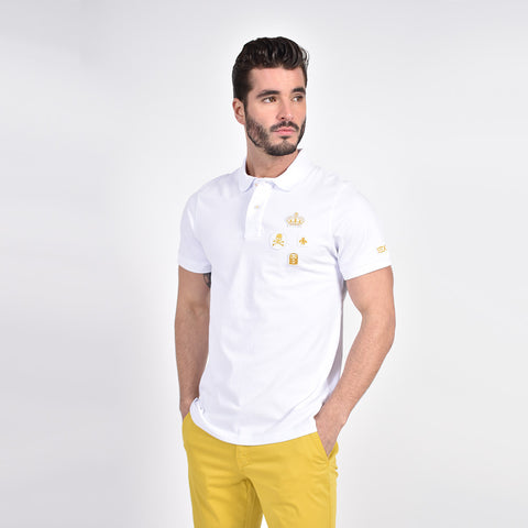 White polo with multiple gold patches.