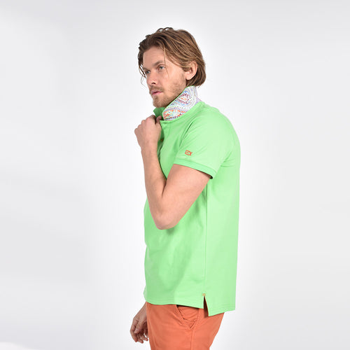 Light-green polo with reversible collar: multi-color paisley print on reverse.