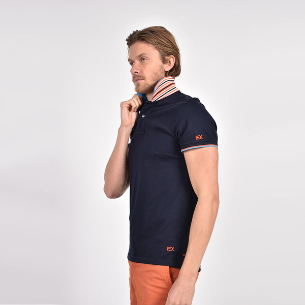 Navy-blue polo with reversible collar and striped, ribbed armbands.