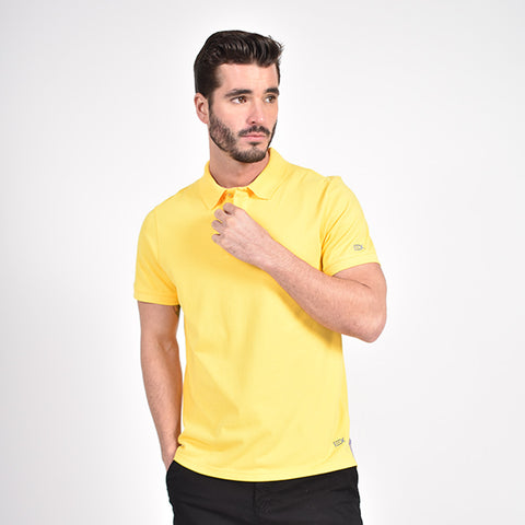 Yellow polo with embroidered lilac EX logo on sleeve and bottom hem.