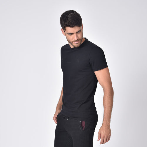 "Model in black, short-sleeve cotton crew-neck with silicone ""EX Premium Sport"" logo on front."