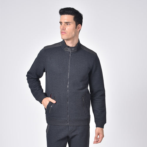 Model in grey, quilted moto jacket with full front-zipper, double zip pockets, and snap-button collar.