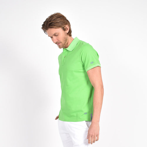 Green polo with embroidered lilac EX logo accents.