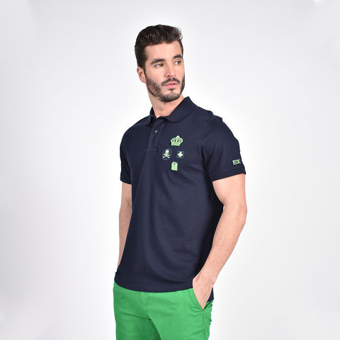 Navy-blue polo with multiple green patches.