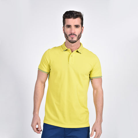 Model in yellow polo with diamond grid jacquard collar; two-button placket; and striped ribbed armbands.