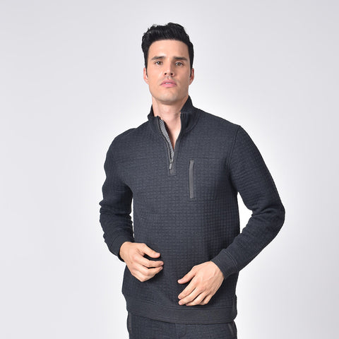 Model in grey, quilted track jacket with hidden half front-zipper and chest-pocket.