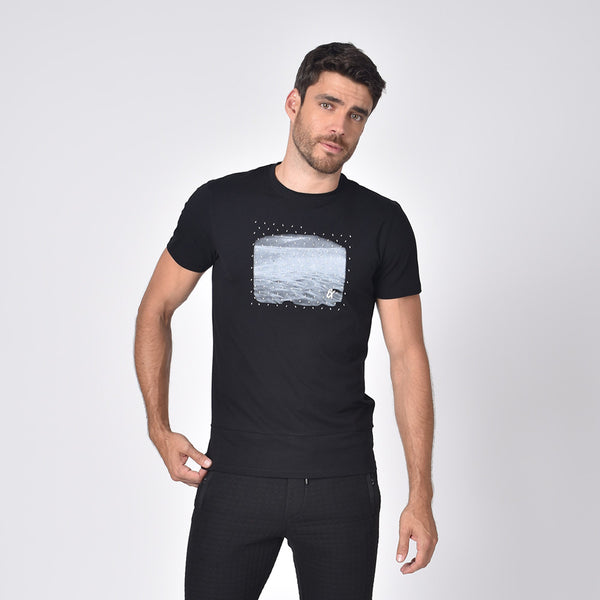 Model in black, short-sleeve cotton crew-neck with silicone print design on front.