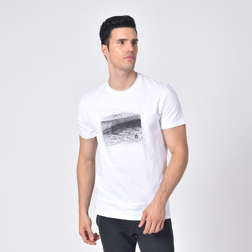 Model in white, short-sleeve cotton crew-neck with silicone print design on front.