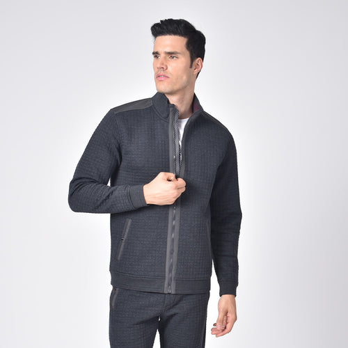 Model in grey, quilted track jacket with full front-zipper and front snap-button pockets.