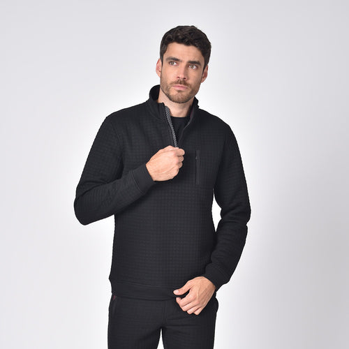 Model in black, quilted track jacket with full front-zipper and side snap-button pockets.