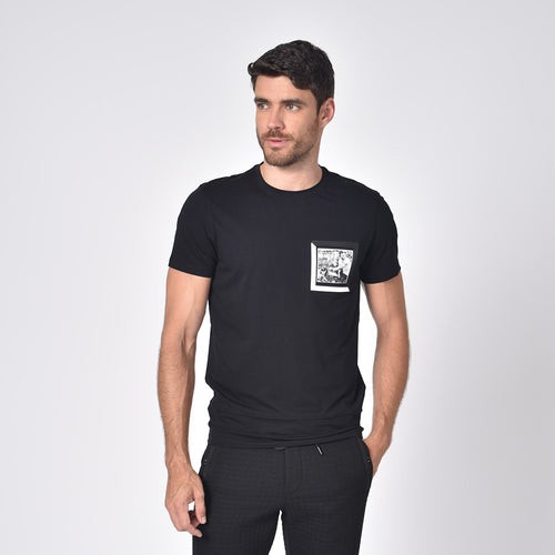 Model in black, short-sleeve cotton crew-neck with black and white chest-patch of biker.