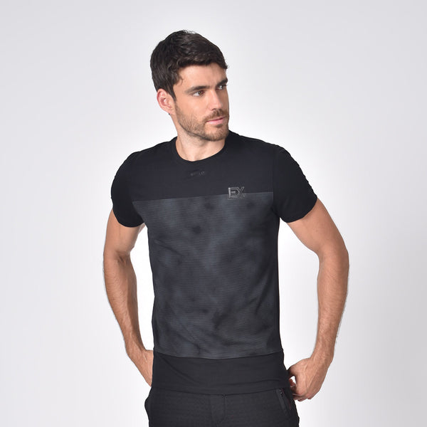 "Model in black, short-sleeve cotton crew-neck with distorted grey print and silicone ""EX"" logo."