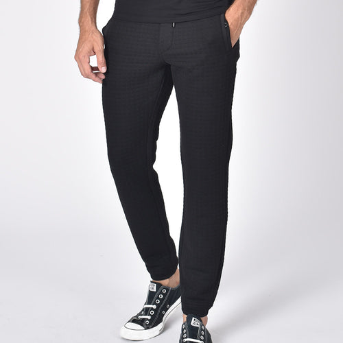 Black, quilted joggers with tapered fit, snap-button pockets, and drawstring waist.