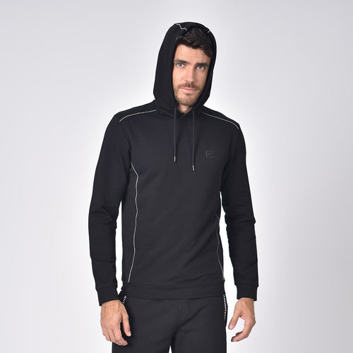 "Model in black hoodie with grey piping, drawstring hood, and silicone ""EX"" logo on chest."