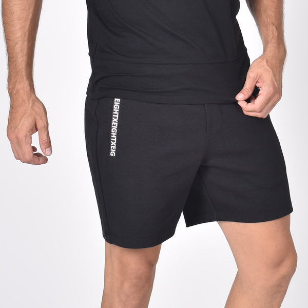 "Mid-length cotton gym shorts with ""Eight-X"" logo on right leg."