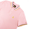 Model in light-pink polo with tipped collar, two-button placket, and striped, ribbed armbands. Featuring embroidered gold frog mascot and embroidered EX Logo on left sleeve.