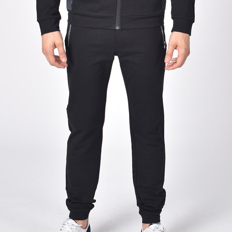 Black, cotton joggers with tapered fit, zip-pockets, and drawstring waist.