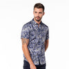 Model in button-up with abstract navy and gray digital print design.