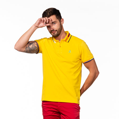 Model wearing yellow polo with striped collar.
