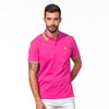 Model wearing fuchsia polo with block-striped collar.